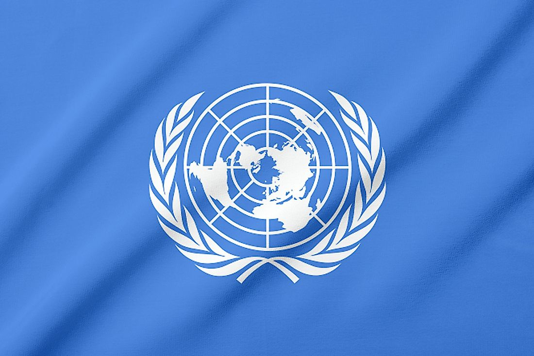 The olive branch wreath represents peace, one of the primary goals of the United Nations.