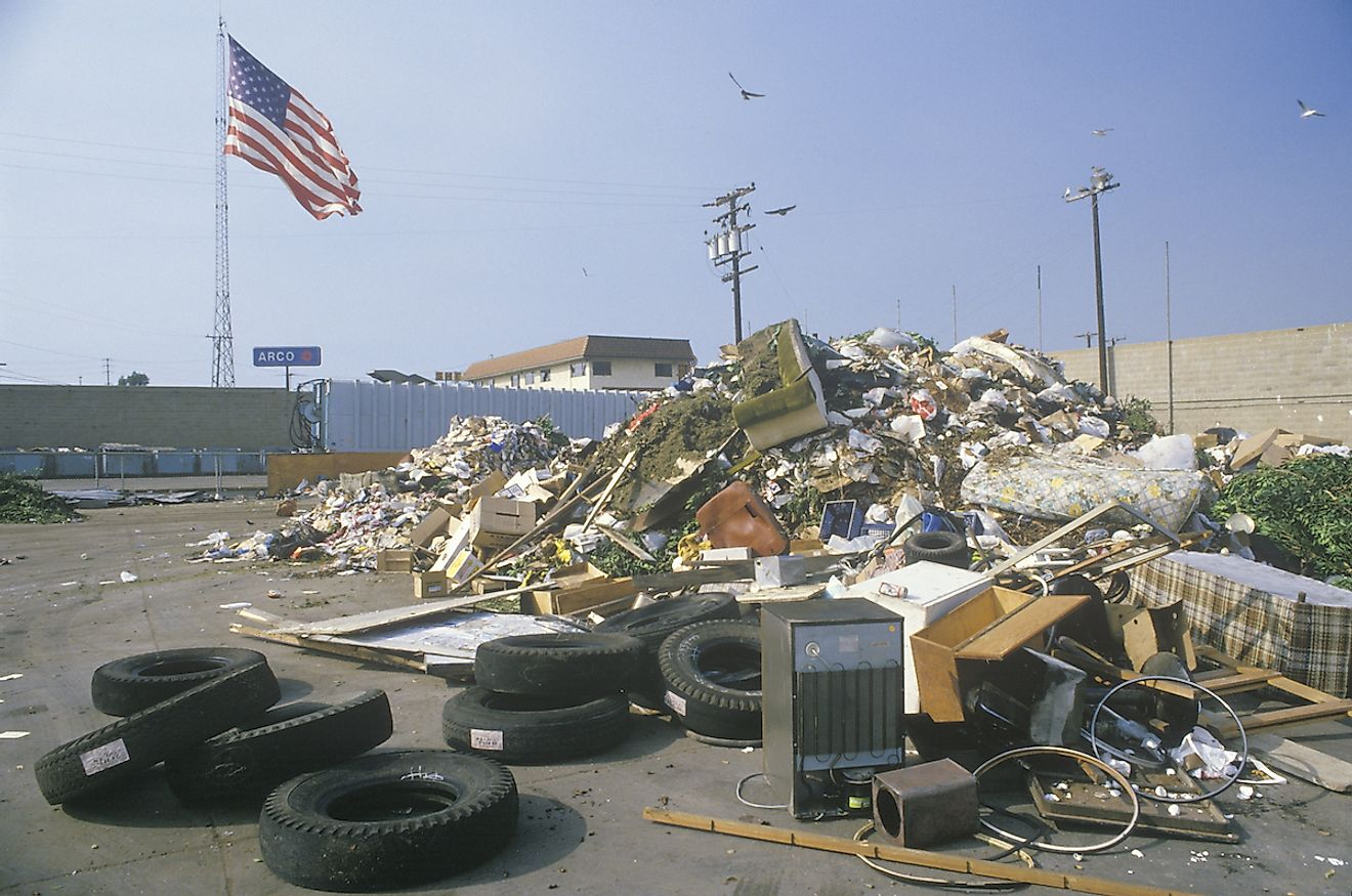 An American flag waving in the distance behind a dump site at the Santa Monica Community Center, CA. Image credit: Joseph Sohm/Shutterstock.com