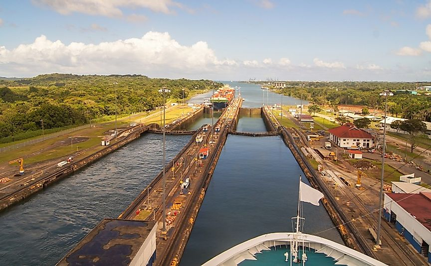 A cargo ship passes through updated locks along the modern-day Panama Canal.