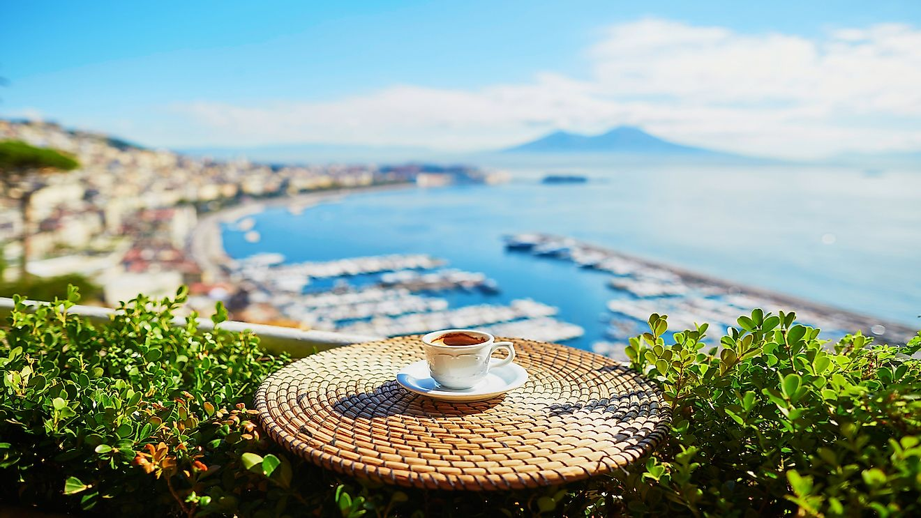 Cup of fresh espresso coffee in a cafe with view on Vesuvius mount in Naples, Campania, Southern Italy.