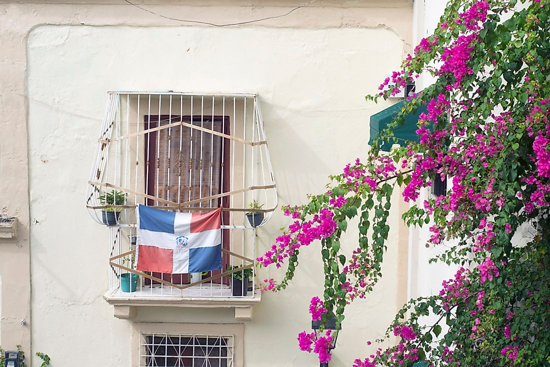 A balcony bearing the flag of the Dominican Republic.