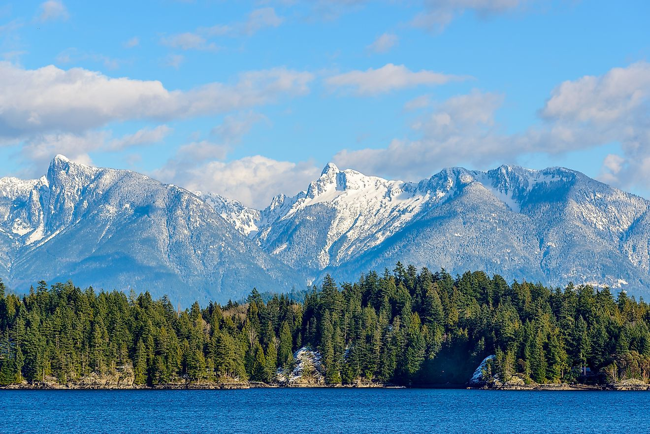 Snow mountain and rocks at Sechelt inlet in Vancouver, Canada. Image credit: karamysh/Shutterstock.com