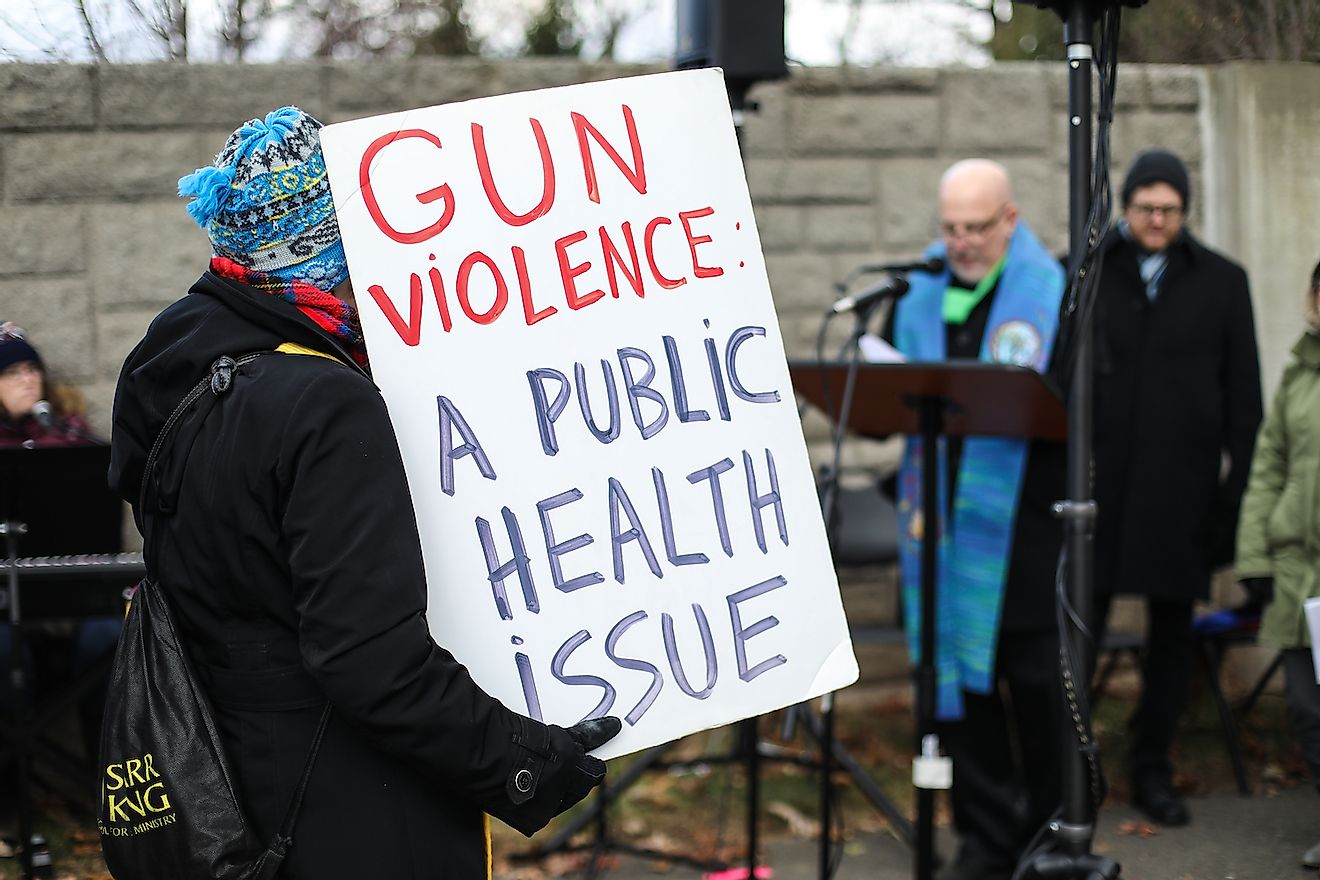 Protesters gather for a vigil outside of the NRA on the fifth anniversary of the Sandy Hook Elementary School shooting in Newtown, Connecticut in 2012. Image credit:  Nicole Glass Photography/Shutterstock.com