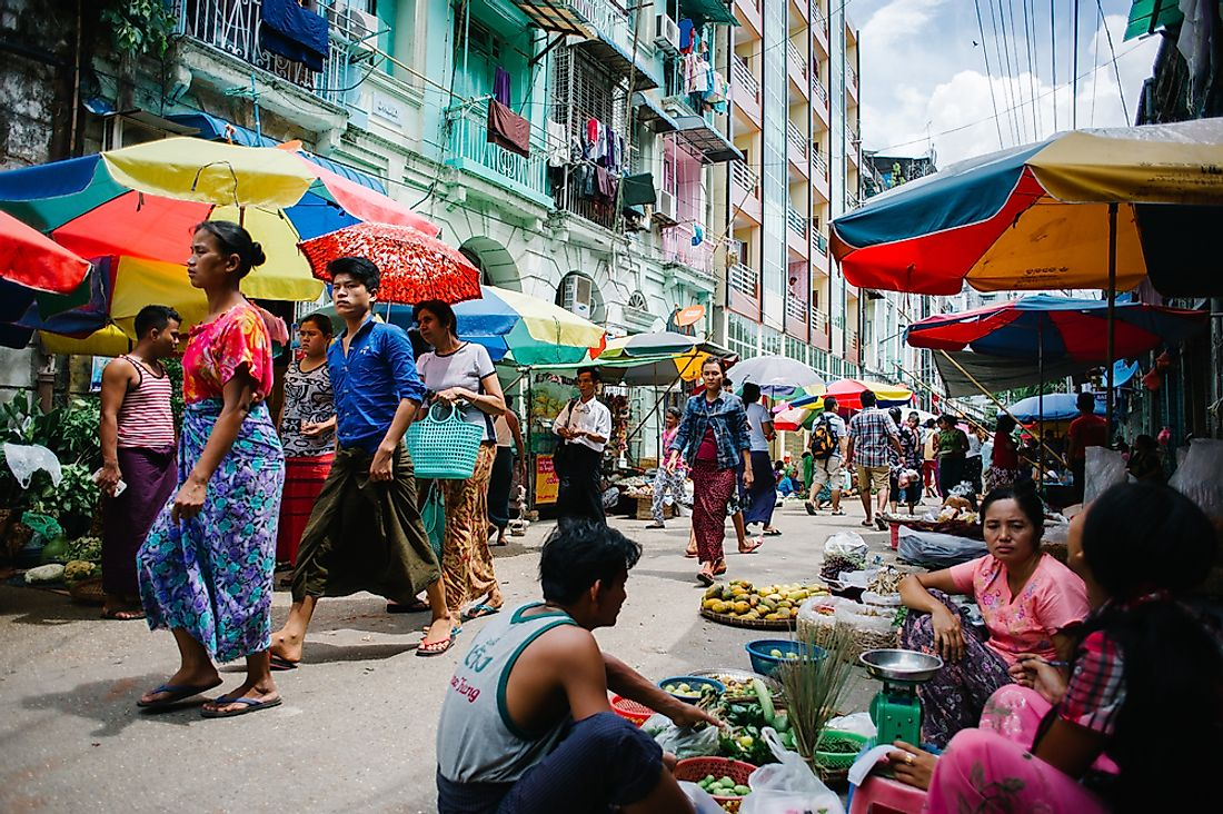 People walk the streets of Yangon, Myanmar. Editorial credit: Alvaro Candia / Shutterstock.com.