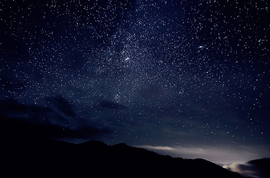 The night sky is filled with tiny bright dots; many are stars, but some are planets.