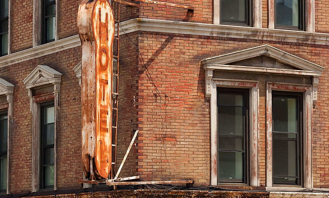 Editorial credit: Antonio Gravante / Shutterstock.com. The sign of a historic hotel in New York shows signs of a fire from earlier days.