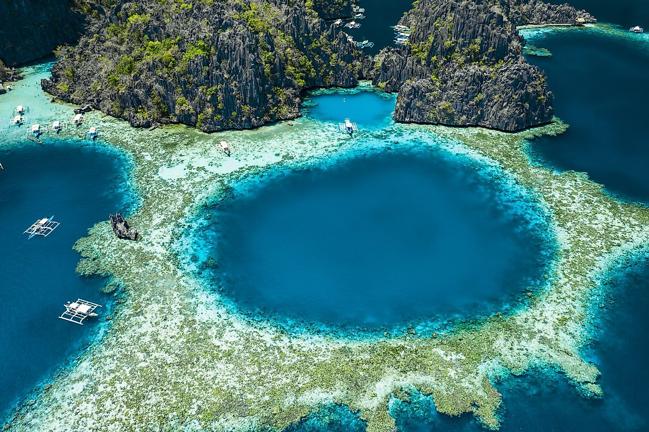 Aerial view of beautiful lagoons and limestone cliffs of Coron, Palawan, Philippines.