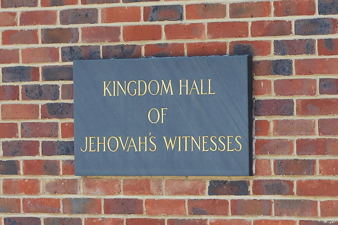 A sign for a Kingdom Hall of Jehovah's Witnesses in London, England. Editorial credit: 1000 Words / Shutterstock.com.