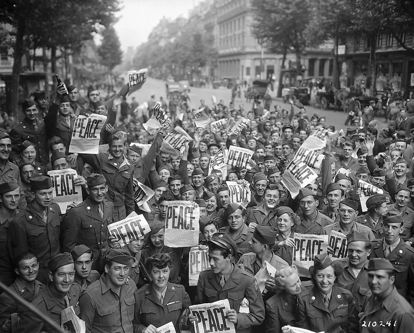 Soldiers of the Allied front celebrate their victory in Paris, France post World War II.
