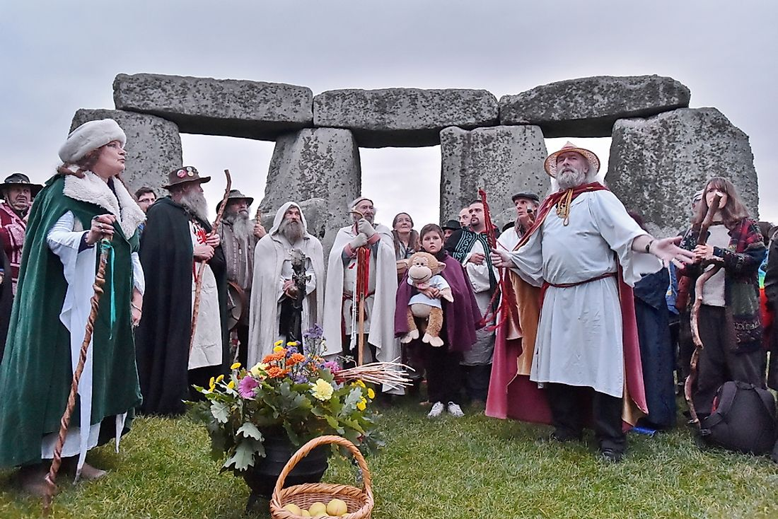 Pagans and druids celebrate the equinox at Stonehenge. Editorial credit: 1000 Words / Shutterstock.com
