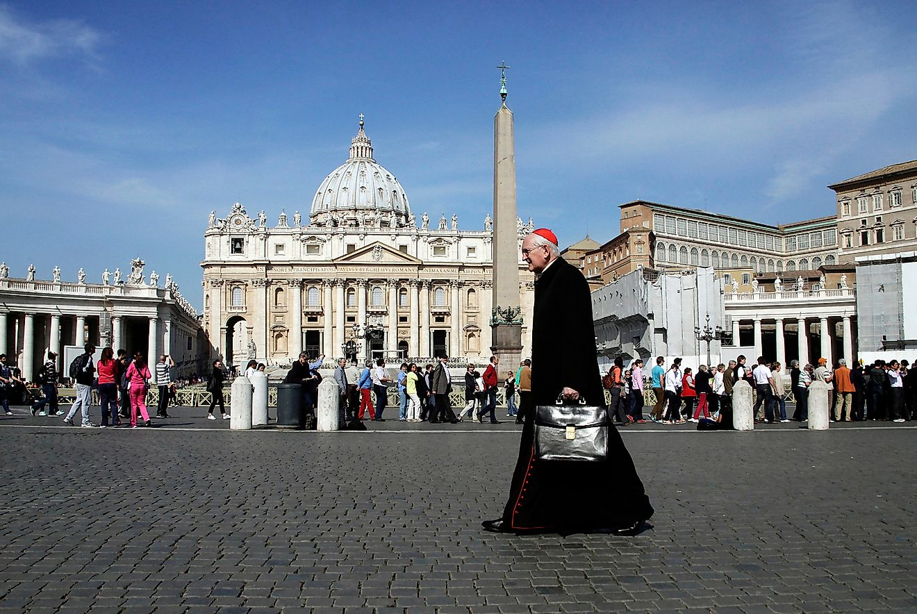 A priest walks at Saint Peter's Square in Vatican City, Vatican. Editorial credit: Alexandros Michailidis / Shutterstock.com