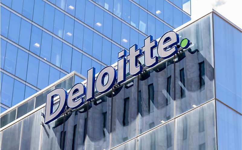 Deloitte sign on the national office building in Toronto. Editorial credit: JHVEPhoto / Shutterstock.com