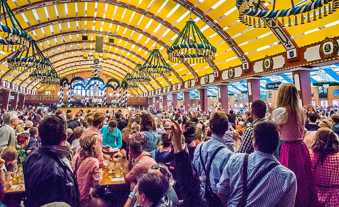 Tourists explore the tents of Oktoberfest in Munich. Editorial credit: Takashi Images / Shutterstock.com.