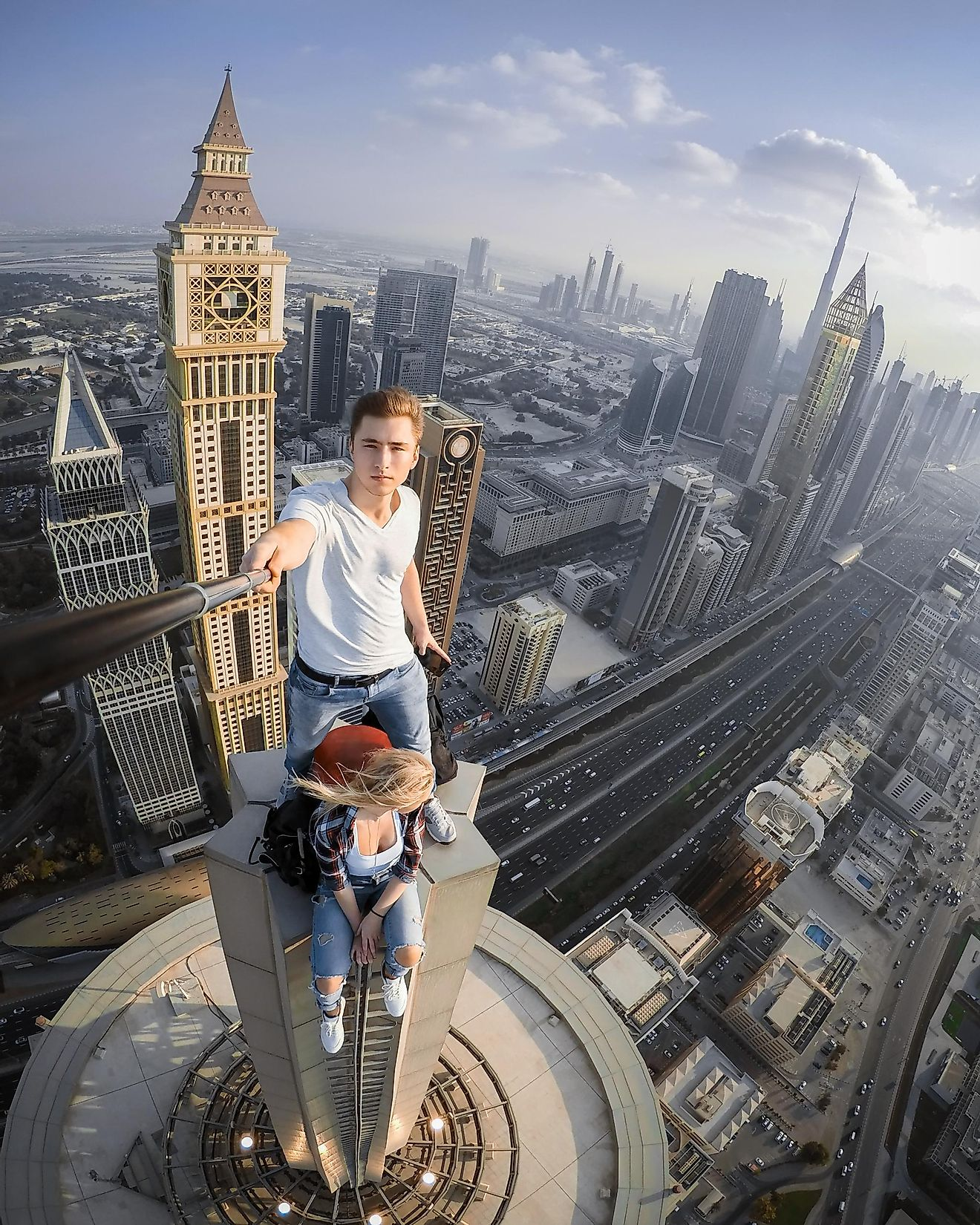 Young couple takes a selfie on a skyscraper in Dubai, United Arab Emirates