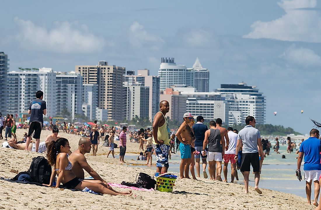 People in Miami Beach. Editorial credit: Alexey Rotanov / Shutterstock.com.