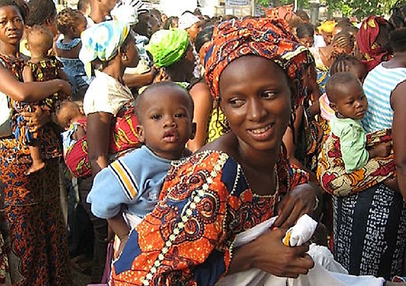 This Sierra Leone woman and her child join crowds celebrating government expansion of maternal healthcare in 2010.