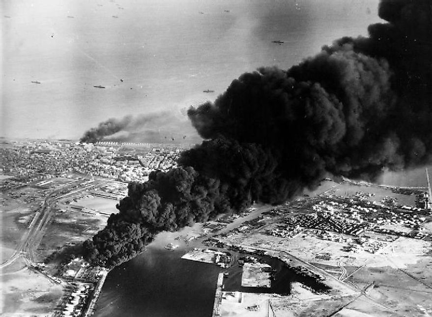 Smoke rises from oil tanks beside the Suez Canal hit during the initial Anglo-French assault on Port Said, 5 November 1956.