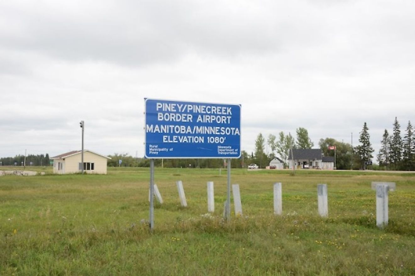 The Piney Pinecreek Border Airport is shared between Manitoba, Canada, and Minnesota, US. Image credit: www.clui.org