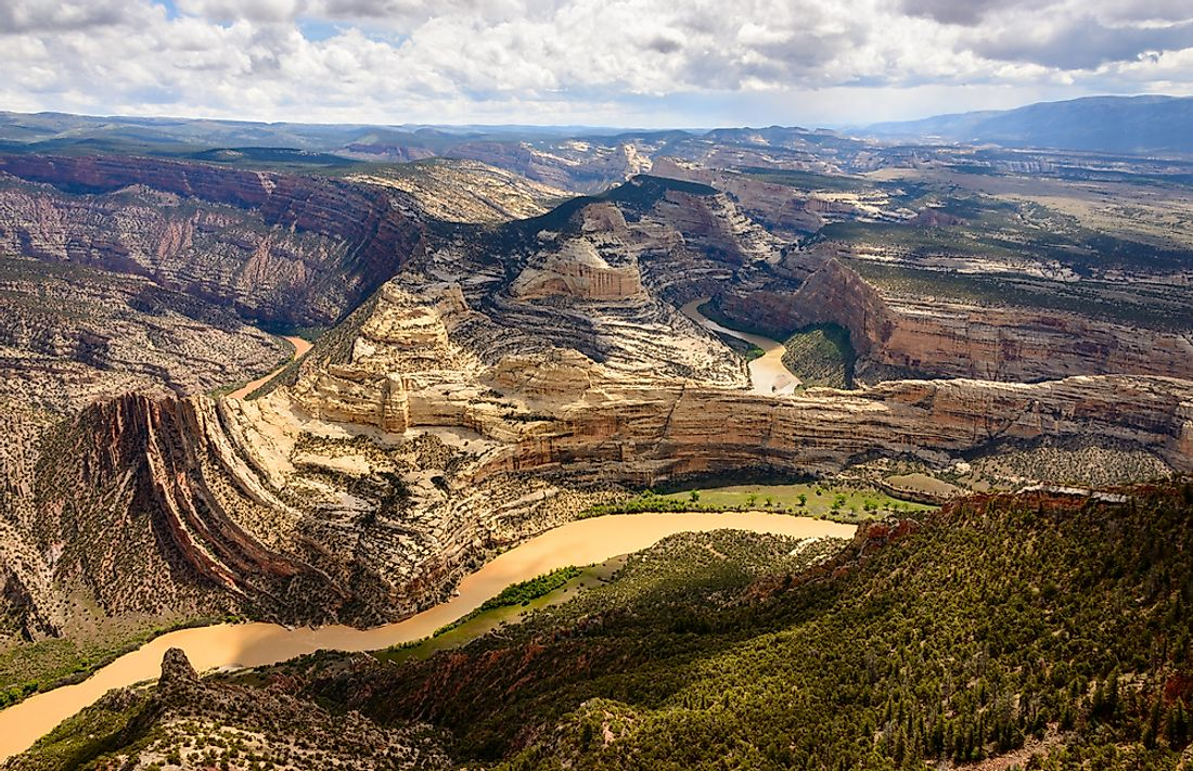 Dinosaur National Monument protects 80 acres of fossil embedded cliffs.