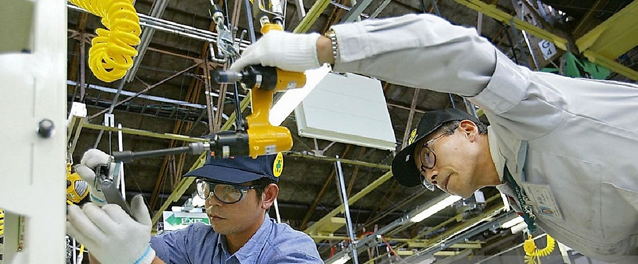 An employee receives on the job training in this Japanese automotive factory.