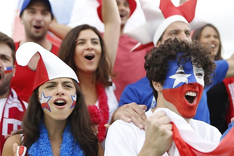 A group of young Chilean adults cheer on their national soccer team.