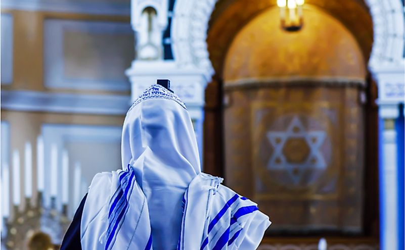 A Jewish man prays in the synagogue.