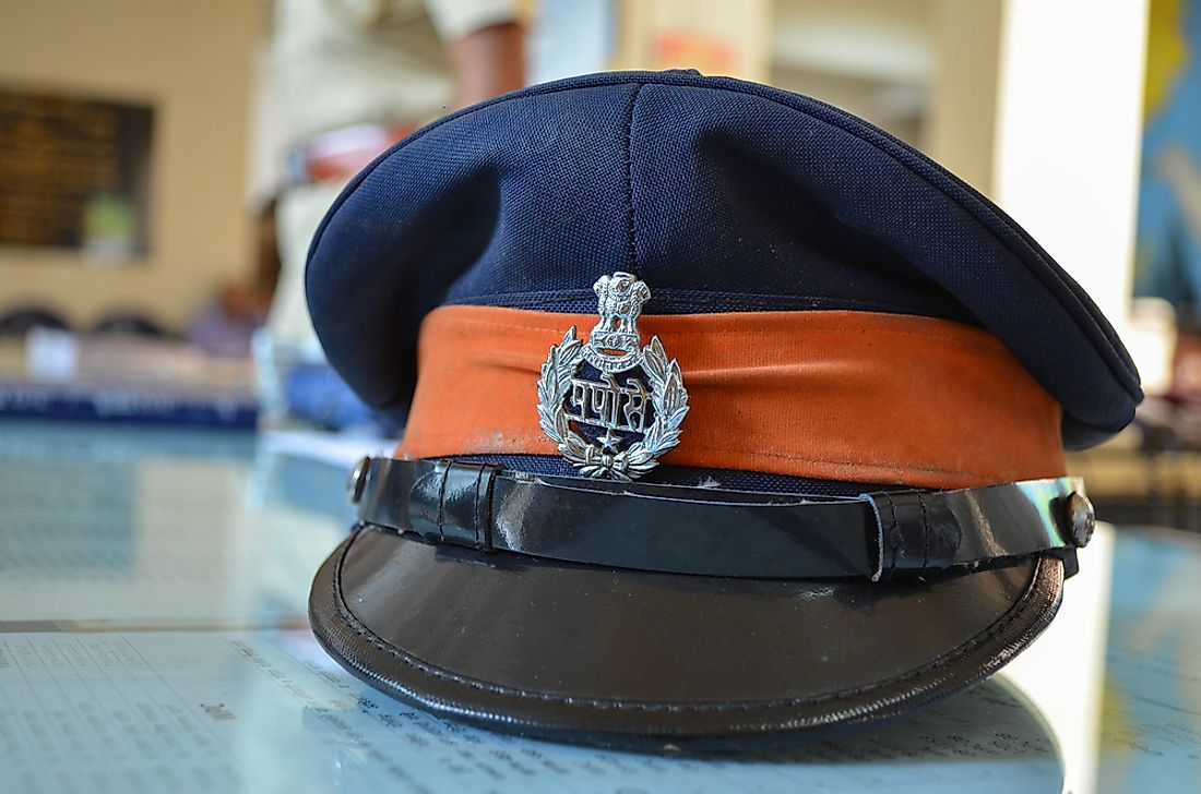 The police hat of a Mumbai officer. Phot credit: Yvdalmia / Shutterstock.com.