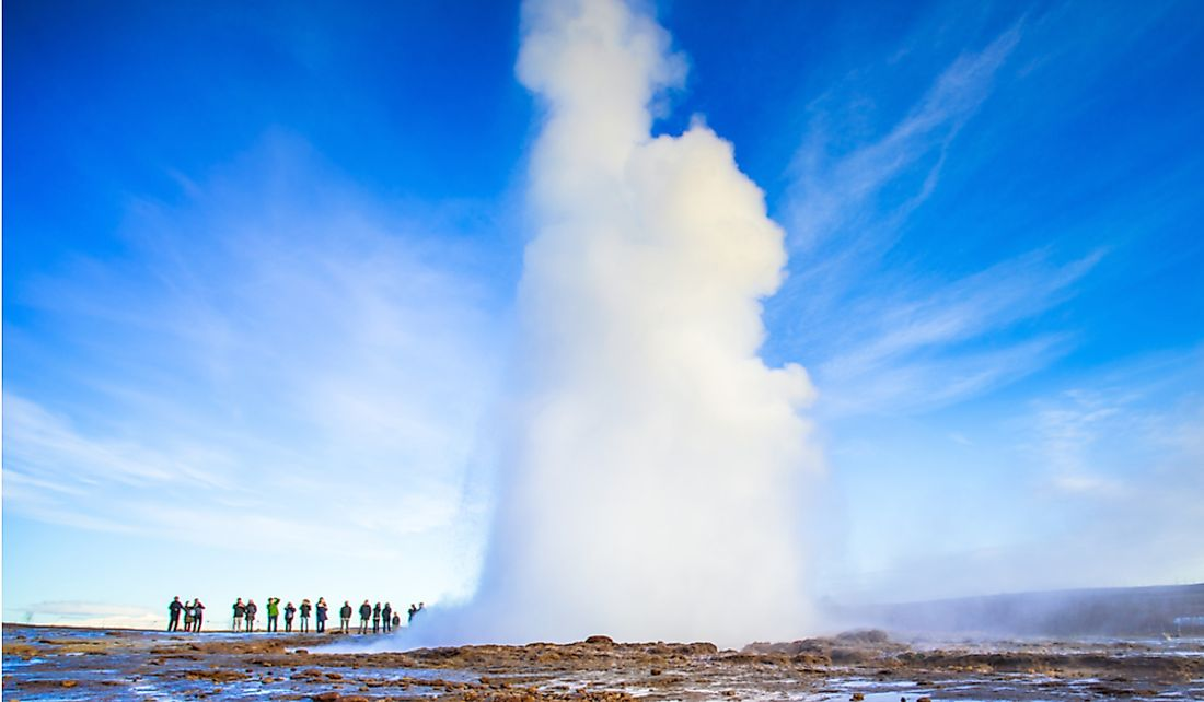 Tourists visit the Strokkur geysers in Iceland.