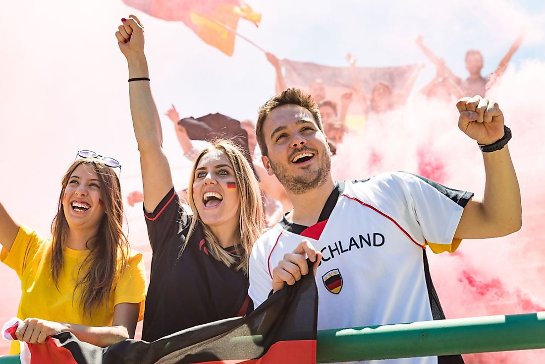 Supporters cheer on the German football team.