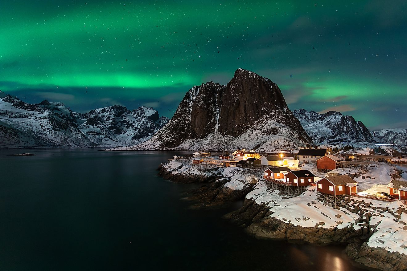 Classic fisherman village in Lofoten island Norway with a beautiful Northern Lights. Image credit: Luca Tagliani/Shutterstock.com