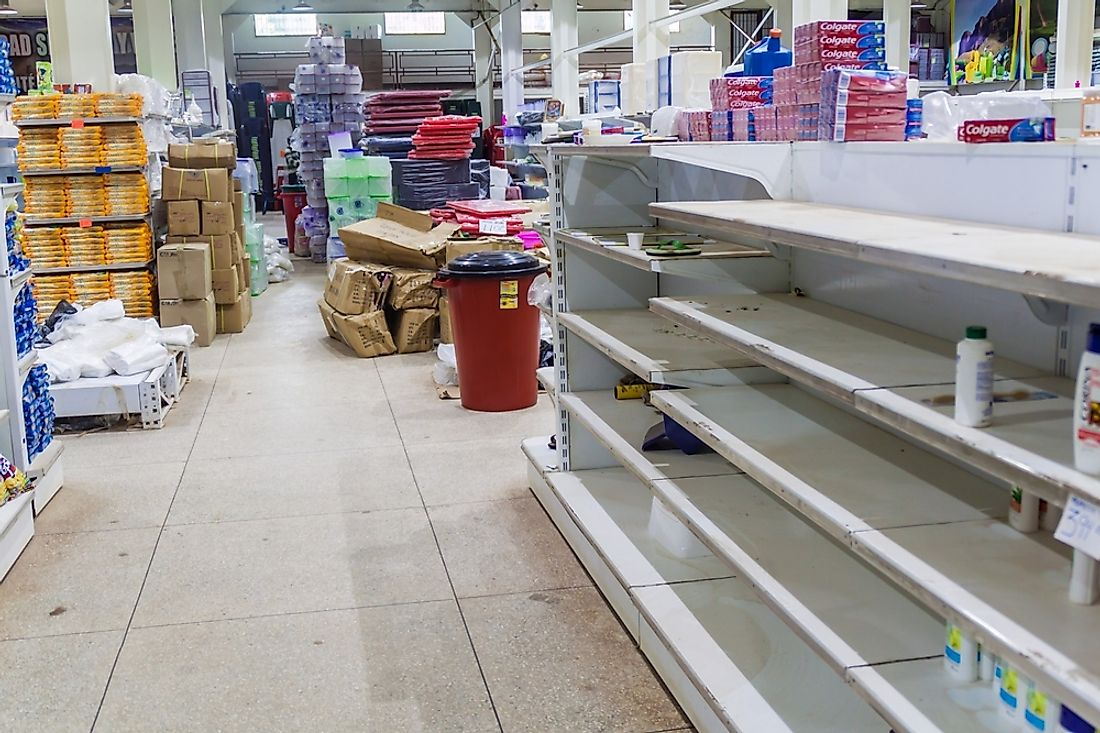 An empty supermarket in Venezuela. Editorial credit: Matyas Rehak / Shutterstock.com.