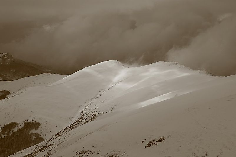 Snow and clouds upon the peak of Midzor in Serbia.
