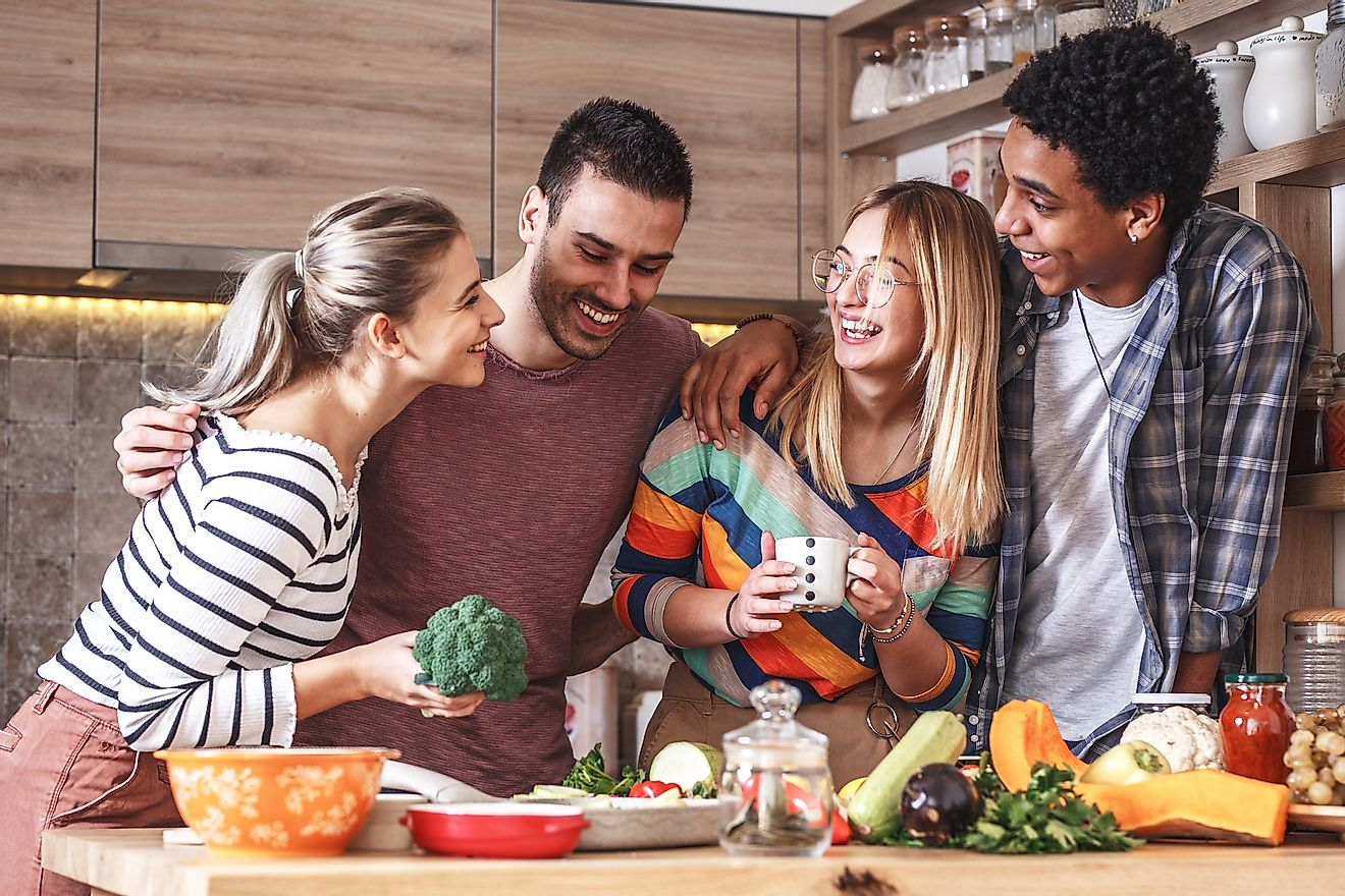 Friends cooking a vegetarian meal. Image credit: Solis Images/Shutterstock.com