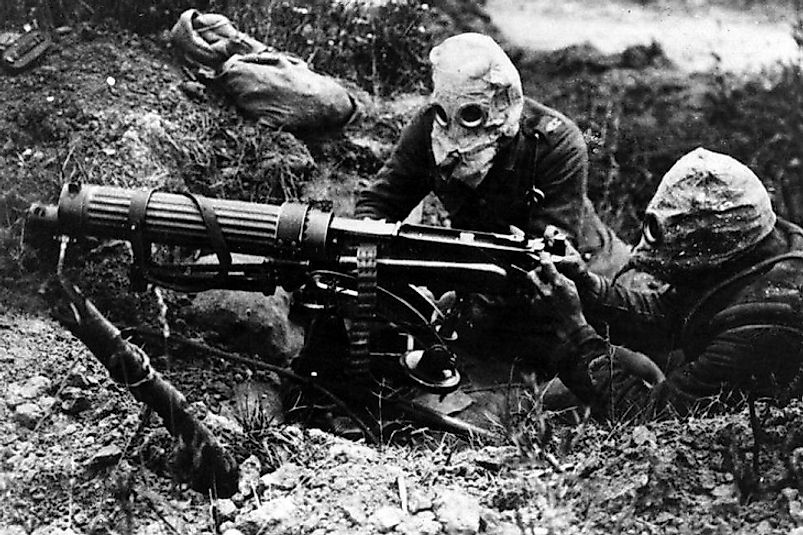 British machine gunners wear masks in their trench positions to defend against German gas attacks in the Battle of the Somme.
