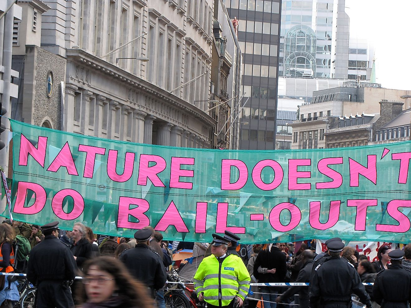 "London / UK - April 1st 2009: Banner reading ""Nature Doesn't Do Bailouts"" strung across Bishops Gate in Central London during protests about the G20 summit. Image credit: Heardinlondon/Shutterstock.com"