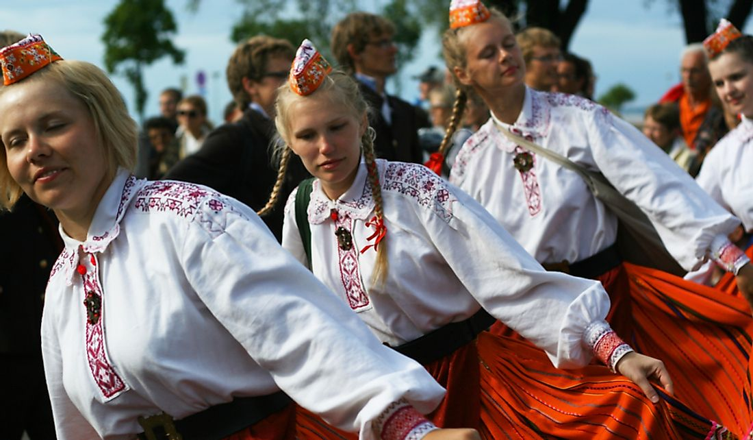 Young women dancing at a traditional Estonian folk music festival.  Editorial credit: Jaagurak / Shutterstock.com