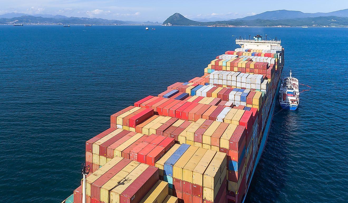 A cargo ship in Nakhodka. Russia. Editorial credit: VladSV / Shutterstock.com S M L  Size Guide.
