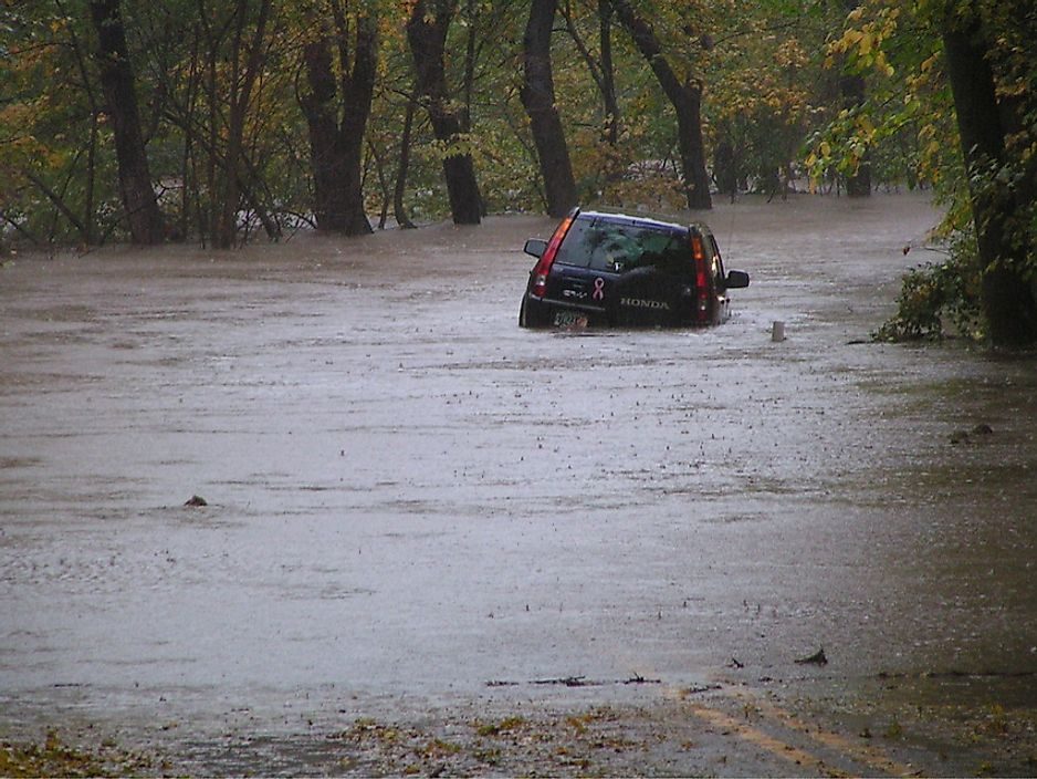 A car partially submerged from the quick rising waters of a flash flood.