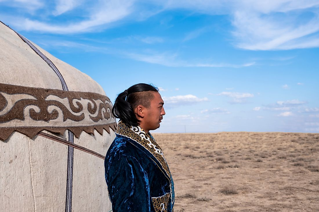 A Kyrgyz man dressed in a traditional outfit. Editorial credit: Ahmet Cigsar / Shutterstock.com.