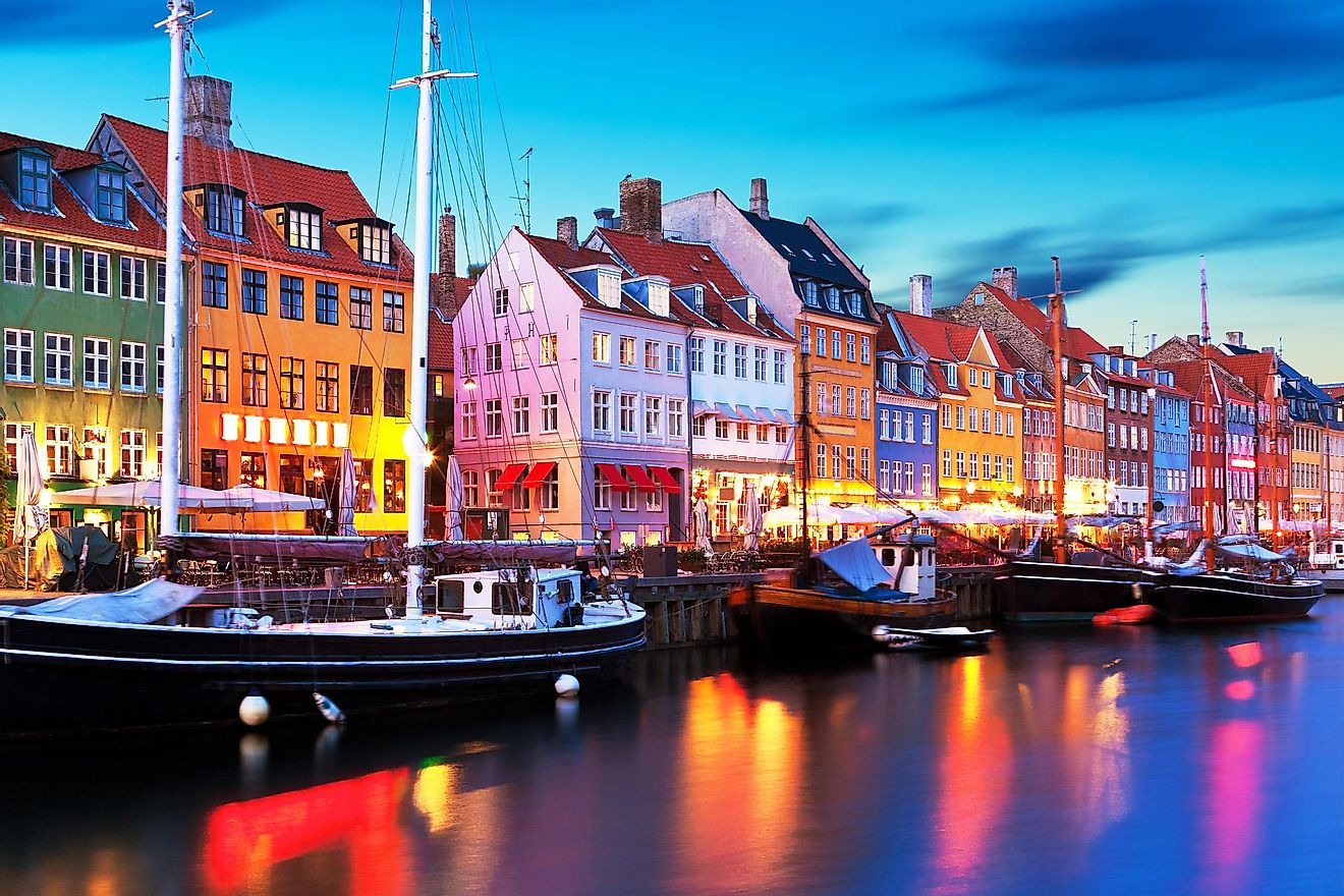 Scenic evening panorama of famous Nyhavn pier architecture in the Old Town of Copenhagen, Denmark.