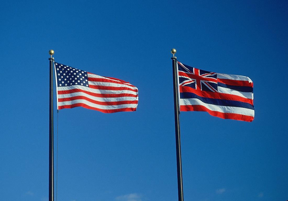 The state flag of Hawaii next to the flag of the United States.