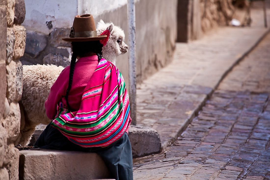 A woman in traditional clothes in Cuzco, Peru.