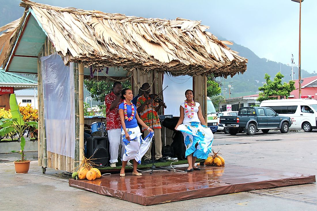 Dancers and musicians from Seychelles welcome cruise ship passengers. Editorial credit: bumihills / Shutterstock.com.