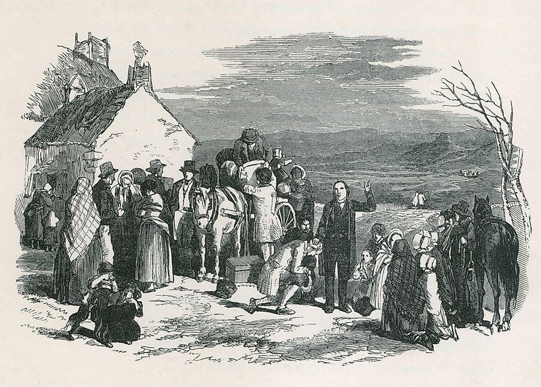 An Irish priest blesses immigrants who are fleeing their homes from the potato famine.