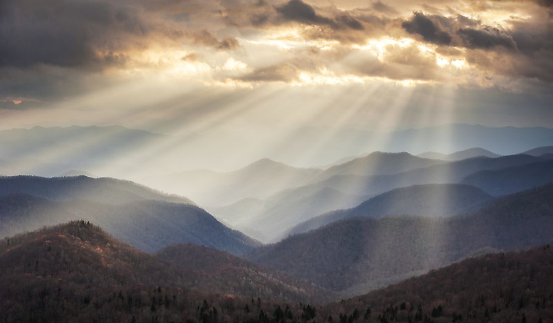 Crepuscular rays light up portions of the Blue Ridge Mountains in North Carolina.