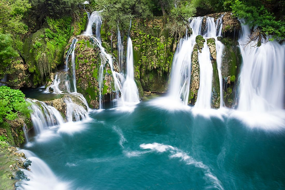 A scenic view of a waterfall in the Una National Park of Bosnia and Herzegovina.