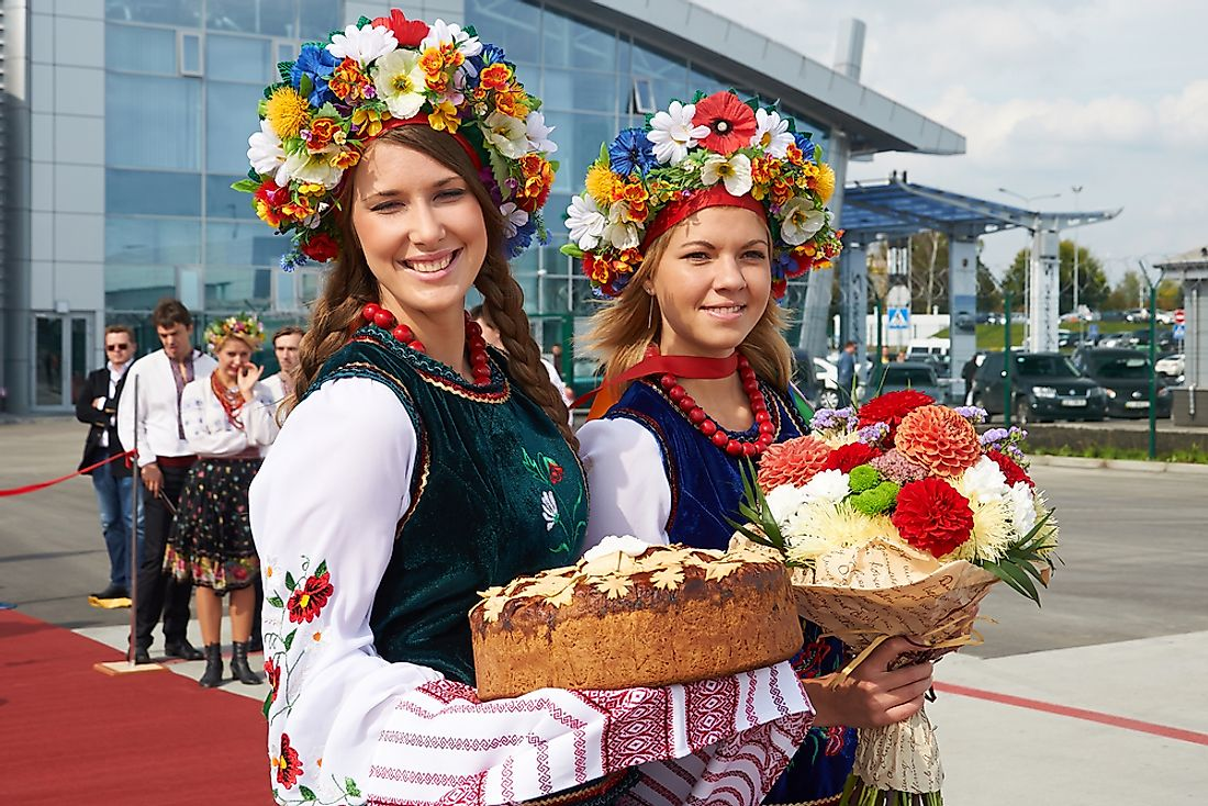 Women dressed in national costumes at the airport in Kiev.Editorial credit: Dmitry Birin / Shutterstock.com.