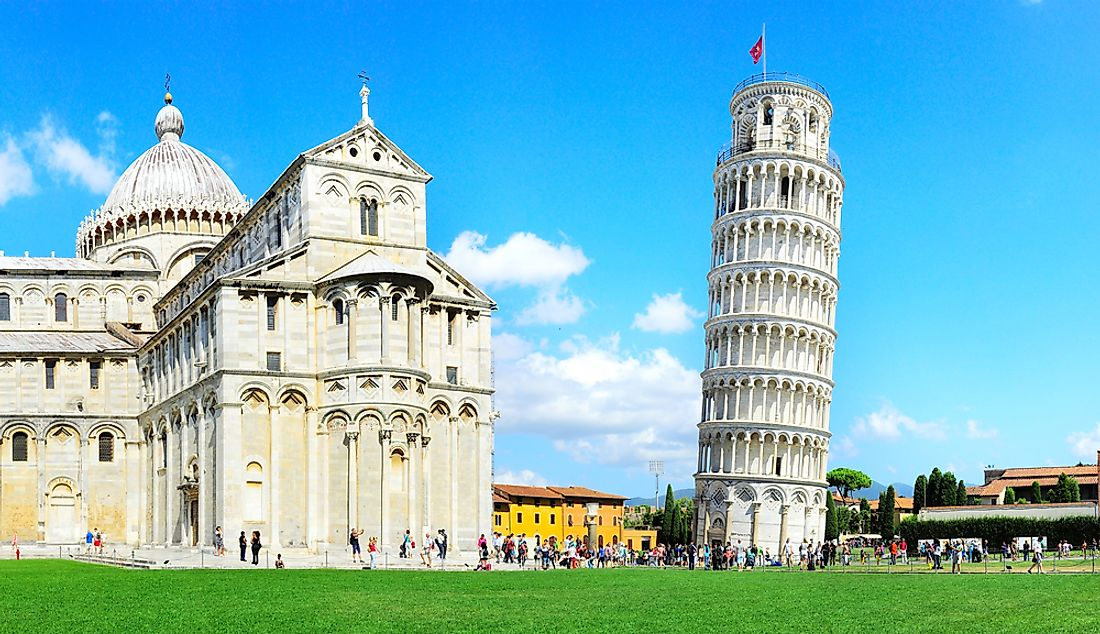 The Learning Tower of Pisa (right) beside the Pisa Cathedral.