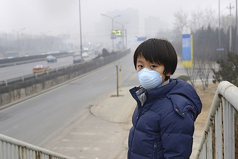 A young man in Beijing wears a mask to protect his respiratory tract from smog in one of the world's worst urban areas in terms of air quality.
