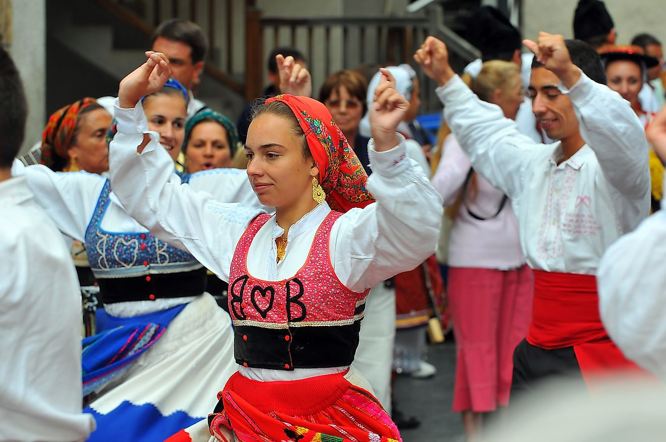 Portuguese people in their traditional costume dancing and celebrating life. Image credit: mountainpix/Shutterstock.com